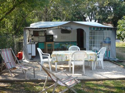 Photo for LARGE CARAVAN WITH AWNING - IN GARDEN OF 3000 M2- SWIMMING POOL OF 11 m X 5 m