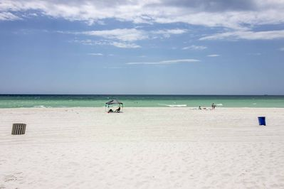 Enjoy spending your days at the beach located just steps from your door!
