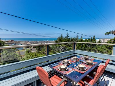 Photo for Oceanview home w/ a beautiful deck & private playground, blocks from the beach!