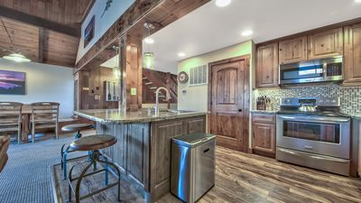 Photo for Ultimate  ski, beach and family Retreat... remodeled with filtered lakeviews!