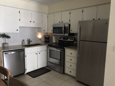 New stainless appliances with granite counters.