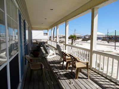 The front porch offers a cool place to relax and look for dolphin swimming by.