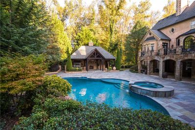 Pool house with professional grill and kitchen
