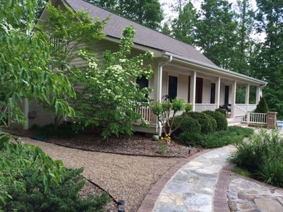 paved walks lead to your upstairs entry from the outdoor living area and parking