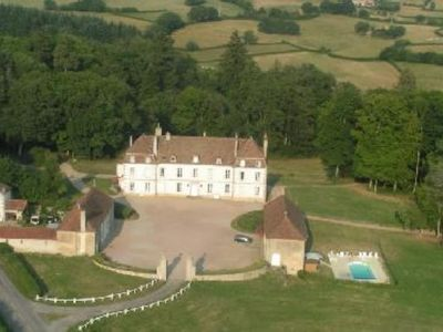 Photo for Detached wing of a castle with a pool near Autun (5 km)
