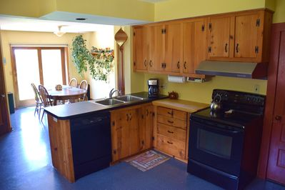 Kitchen with all modern appliances. Dining area has great sunset views.