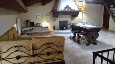 Photo for Beautiful penthouse in a historic village of Montefeltro in the Marche