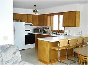 spacious  full kitchen with breakfast bar and dining area