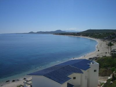 Photo for Beachfront Villa, walk to town, amazing views & safe swimmable beach. - 2 Bdrm