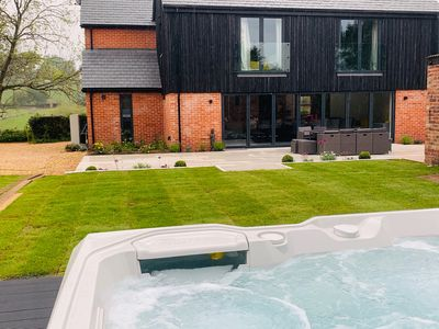 """Photo for Boutique luxury house with """"Hot Tub"""" in rural New Forest, sleeps 12"""