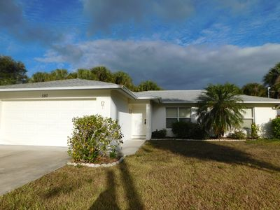 Photo for Dolphin - Nice home overlooking lake, minutes to shops, restaurants, beaches.