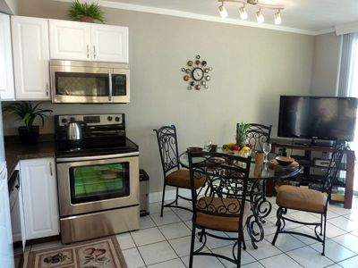 FULLY EQUIPPED AND UPDATED KITCHEN & DINING ROOM