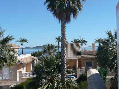 Photo for View of the sea and the private garden with palm trees and an olive tree.