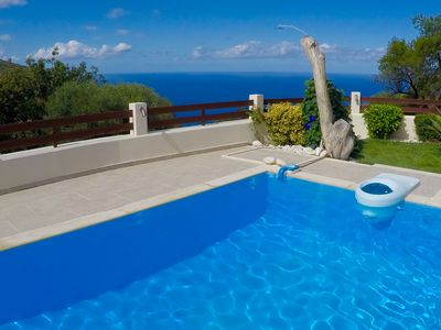 Photo for Modern spacious villa with private pool, large garden and sea view/sunset