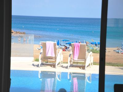 Photo for Spectacular BEACH FRONT Villa - DIRECT access to the SANDY BEACH -  Protaras