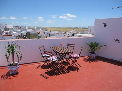 Photo for Trendy apartment with large private terrace in the old town only 400m from beach