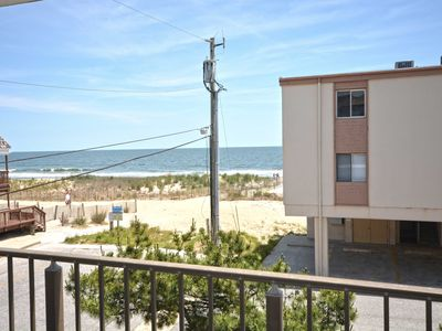 Photo for Cute, casual 2-bedroom condo with free WiFi and a partial ocean view located midtown and less than a block to the beach!