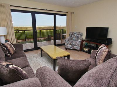 Photo for Ground Floor Condo, Just Steps Away From The Beach