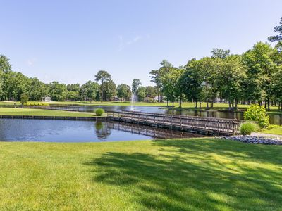 Photo for Dog-friendly condo with shared pool plus lake, canal, and golf course views