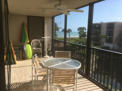 Sit and relax on large screened porch. 1 Minute walk to beach.
