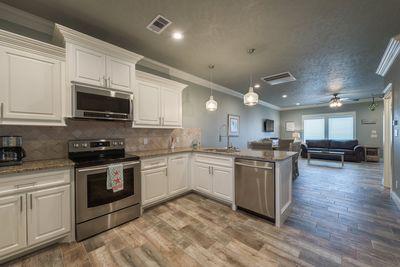 Spacious open concept w/kitchen, living and dining area & eat up bar