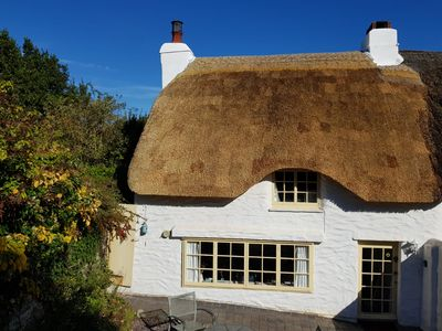 Photo for Charming coastal cottage - close to beach & coast path.  Newly re thatched!