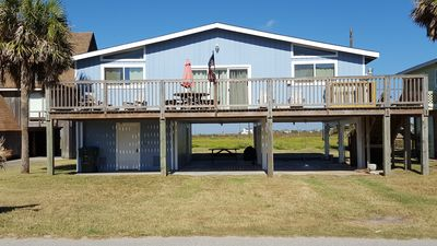 Photo for Colorful 3rd row beach home with view