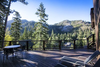 Back Deck - Large and spacious! Easy access off kitchen/dining area. Features a dry Sauna, propane BBQ, incredible sunrises and sunsets and mountain views!