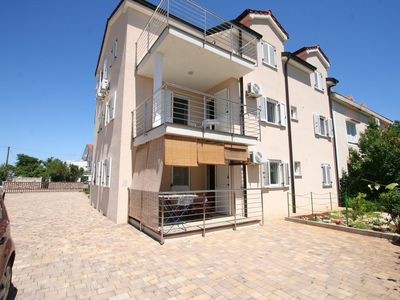 Photo for Holiday apartment away with air conditioning and only 250 meters from the beach