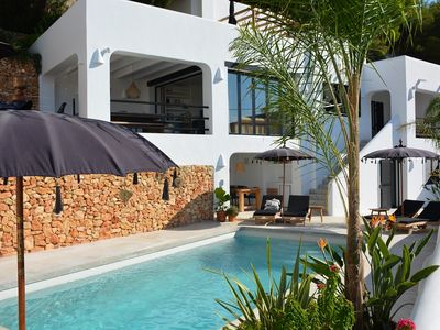 Photo for Ibiza-style villa with swimming pool and sea view