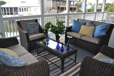Sit Back and Enjoy the Gulf Breeze and Watch the Birds fly by.