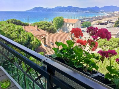 Photo for CANNES vacation rentals, sea view, 3 swimming pools, parking, beach at 50 meters