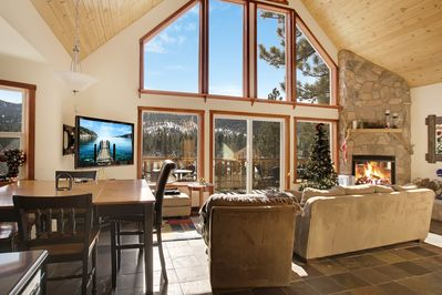 """Living Room - A sun-soaked open living area has seating for 5 across from the 55"""" Toshiba wall-mounted TV"""