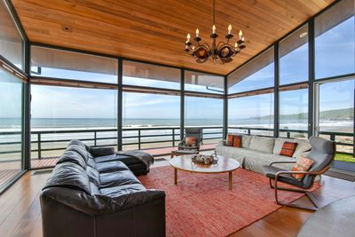 The living room offers unbeatable 270 degree views of the beach and ocean