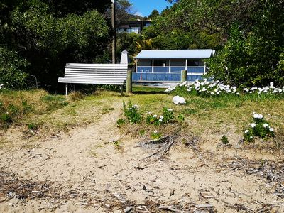 Listing is for the REAR Cottage.  Photo shows proximity of property to beach.