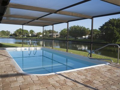 Photo for Quiet pool home with lake view, close to beaches, shopping & restaurants