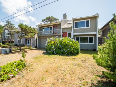 Photo for Cozy family home less than a block from secluded beaches in the village!