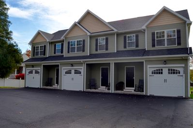Front of townhouse.  Driveway and single car garage for off street parking