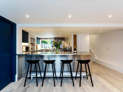 Photo for Sophisticated 4BR with garden & roof terrace 10 min from Oxford Circus, by Veeve