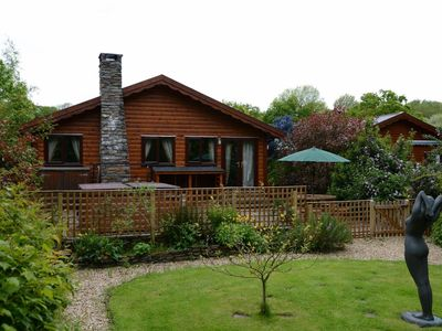Photo for Milk Wood Bach with private Hot Tub, Sauna, Woodburner, large Garden and stream