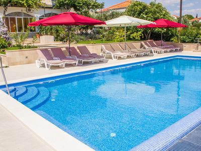 Photo for Holiday apartment with pool and 80 m to the beach