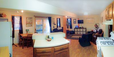 Panoramic view of the kitchen to living room from the entrance
