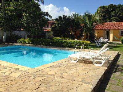 Photo for Furnished house great facilities pool gardens barbecue beach air condic
