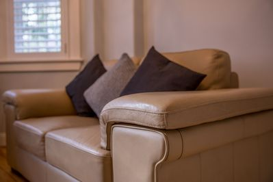 Leather lounge suite for two with plush pillows