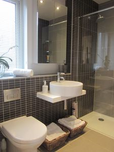 En--suite with mains pressure walk-in shower
