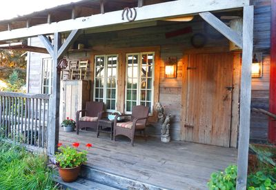 Sit and relax on the porch and if it rains the metal roof will lull you to sleep