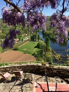 the terrace from house entry  above  with wisteria