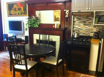 dining table, stove, fireplace, chairs