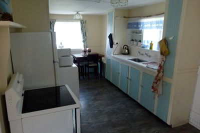 Self-catering kitchen with glass top cooker