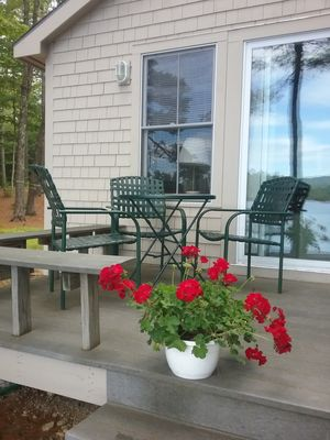 Photo for Charming lakefront cottage with sandy beach on a large private wooded lot